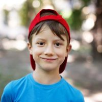 6 year old boy with cap